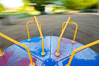 Viewer is along for the ride as this merry-go-round spins greating a blurry background.